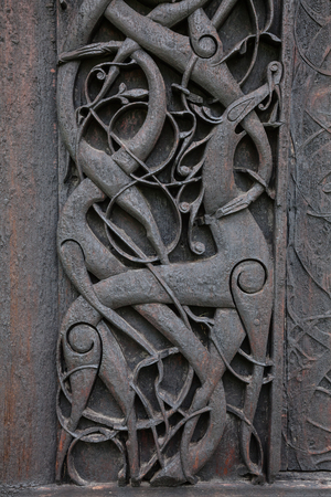 11-th century wooden carvings on door jamb of Urnes Stave Church (Urnes stavkyrkje), listed as World Heritage Site and one of the oldest remaining stave churches in Norway. Ornes, Luster, Sogn og Fjordane county, Norway Stock Photo
