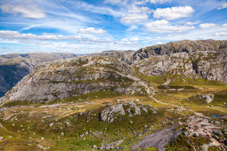 Marked mountain hiking trail along the Lysefjord to Kjeragbolten boulder at Kjerag (or Kiragg) Plateau, a popular travel destination in Forsand municipality of Rogaland county, Norway, Scandinavia