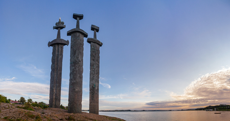Panoramic view of Møllebukta bay with Swords in Rock (Sverd i fjell) monument, three large bronze swords planted into the rock commemorating the Battle of Hafrsfjord in 872 united Norway, Stavanger, Rogaland, Norway, Scandinavia 写真素材 - 123022826