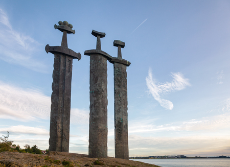 Swords in Rock (Sverd i fjell), three large bronze swords planted into the rock in Møllebukta bay, monument commemorating the Battle of Hafrsfjord in 872 united Norway, Stavanger, Rogaland, Norway, S