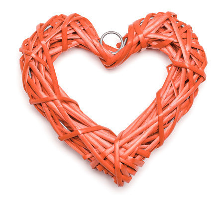 Coral color heart shaped braided wicker on white background