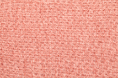Living coral trendy color of the year 2019 knitted fabric made of heathered yarn textured background 写真素材