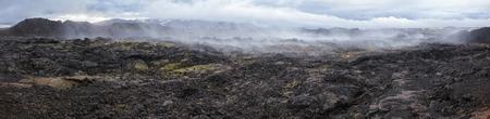 Panoramic view of steaming lava field at Krafla volcanic area in Mývatn region, Northeastern Iceland, Scandinavia Standard-Bild - 118202085