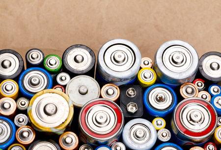 Used Alkaline batteries of various types (C AA AAA D 9V) on recycled paper ready for recycling - toxic waste and environmental issues concept Standard-Bild - 118202104