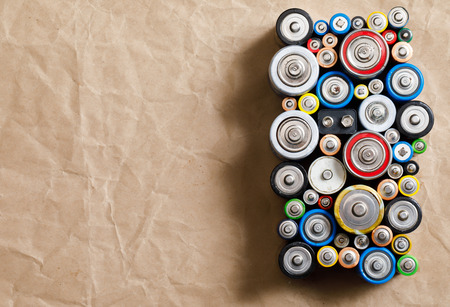 Used Alkaline batteries of various types (C AA AAA D 9V) on recycled paper ready for recycling - toxic waste and environmental issues concept Standard-Bild - 118202149