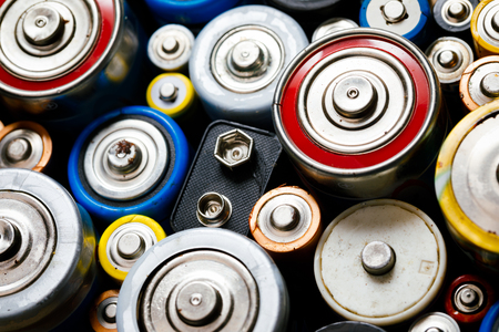 Dumped used Alkaline batteries of various types (C AA AAA D 9V) ready for recycling - toxic waste and environmental issues concept Standard-Bild - 118202151