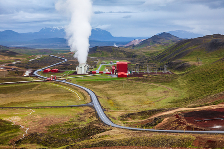 Steaming cooling tower at Krafla geothermal power plant, the largest Icelands power station near Krafla Volcano, Northeastern Iceland, Scandinavia Standard-Bild - 118202152