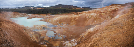 Panoramic view of Leirhnjukur (Clay Hill) rhyolite formation with hot sulfuric springs at Krafla volcanic area in Mývatn region, Northeastern Iceland, Scandinavia Standard-Bild - 118202161