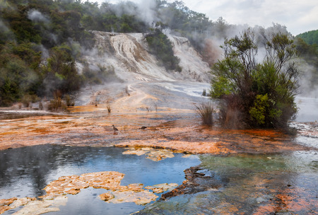 Steaming Orakei Korako geothermal area on the banks of Waikato River, Taupo Volcanic Zone, Northern Island of New Zealand 写真素材