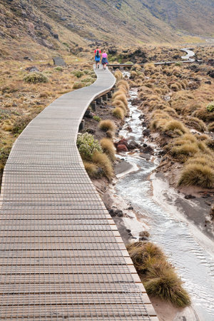Wooden boardwalk at Tongariro Alpine Crossing tramping track, one of the most popular day hikes in New Zealand. Track crossing the Tongariro National Park, the oldest national park and  in central Nor