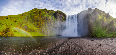 Panoramic view of the Skogafoss, one of the biggest Icelandic waterfalls on the Skoga river, a popular tourist attraction in Southern Iceland, Scandinavia 写真素材 - 122207609