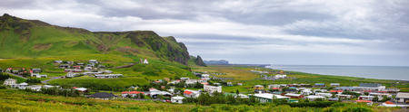 Panoramic view of Vik i Myrdal, the southernmost village in Iceland and popular travel destination for basalt stacks Reynisdrangar, black sand beach and nesting puffins