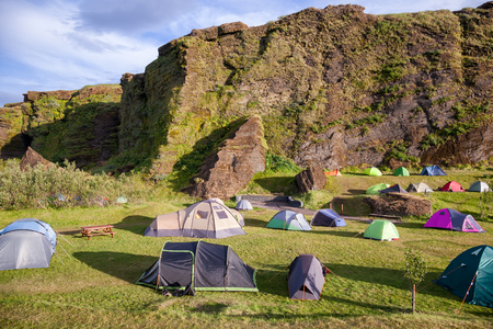Tents at crowded Icelandic campsite at a peak of a season, VIk, Iceland, Scandinavia 写真素材 - 122210832
