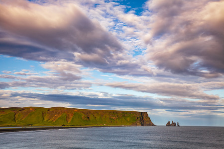 Reynisdrangar basalt sea stacks  on the Reynisfjara black volcanic sand beach near the village of Vík í Mýrdal, a popular tourist attraction on South Coast of Iceland, Scandinavia 写真素材 - 122048939