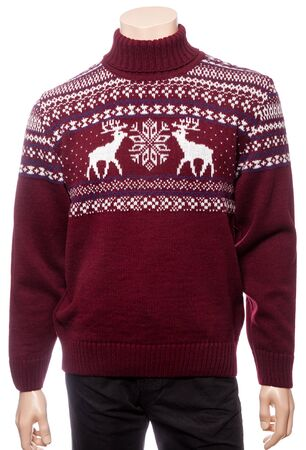 Burgundy knitted Christmas turtleneck sweater of traditional design with moose or elk ornament on a mannequin isolated on a white background