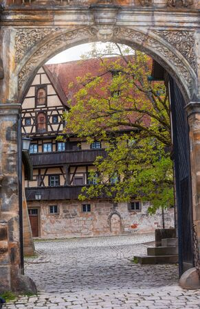 Entrance to the Alte Hofhaltung (Old courtyard), former residence of the bishops now Historic museum, Bamberg Old Town, Bavaria, Germany, Europe. Bamberg is one of most popular travel destinations in Germany.