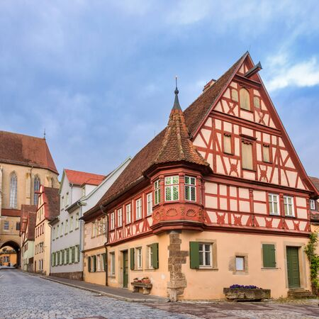 Picturesque half-timbered house in Rothenburg ob der Tauber Old Town, Bavaria, Germany, Europe, one of the most popular travel destination on Romantic Road touristic route