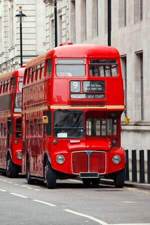 Iconic red AEC Routemaster  double-decker buses parked on a street in Central London UK