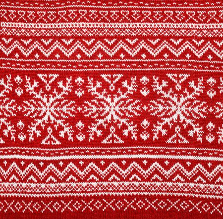 Red knitted fabric with white Scandinavian geometric ornament