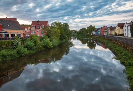 Colorful buildings along the Wornitz river in a morning light, Donauworth, Swabia, Bavaria, Germany
