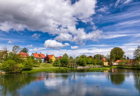 Town park and Rothenburg pond at Dinkelsbuhl Old Town, Central Franconia, Bavaria, Germany, a popular travel destination on Romantic Road touristic route Stok Fotoğraf