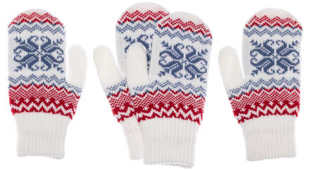 White winter knitted mittens of traditional design with red and blue nordic geometric ornament isolated on white background Stock Photo