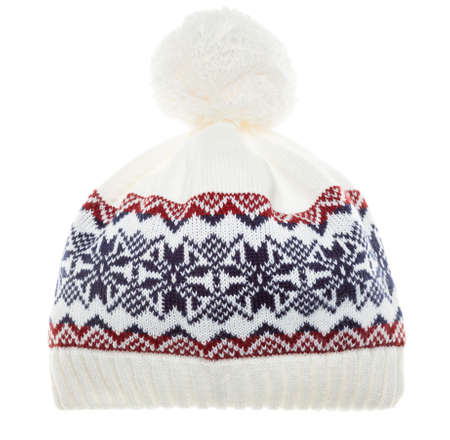 White knitted winter bobble hat decorated with Scandinavian geometric ornament isolated on white background. Handmade woolly cap with pompom on top Stock Photo