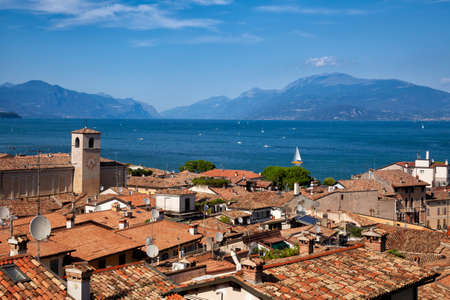 Rooftop view of Desenzano del Garda, a resort town on the southern shore of Lake Garda in  Northern Italy. Lake Garda is the largest lake in Italy and a popular holiday location on the edge of the Dolomites Editorial