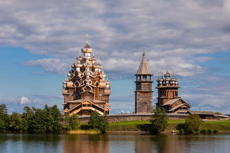 17th century wooden churches and bell tower of Kizhi Pogost historical site on Kizhi Island at Lake Onega, listed as one of the most popular tourist destinations in Republic of Karelia, Russia Editorial