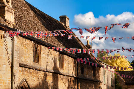 Union Jack flag bunting hanging in a street, a festive decorations in Southwest England, UK Standard-Bild