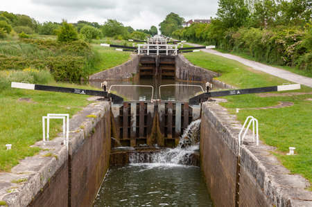 The main flight of 16 locks at Caen Hill Locks on the Kennet and Avon canal near Devizes in Wiltshire, South West England UK