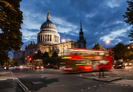 London cityscape with Double Decker bus moves along the Cannon Street near St Paul's Cathedral in twilight Standard-Bild