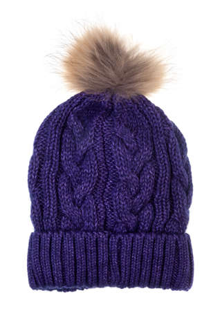 Purple woolly winter bobble hat decorated with cable knitting ornament isolated on white background. Handmade woolly cap with fur pompom on top