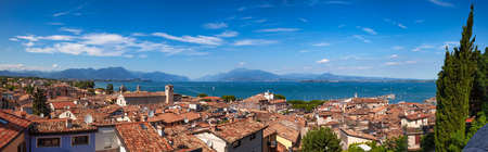 Panoramic view of Desenzano del Garda, a resort town on the southern shore of Lake Garda in  Northern Italy. Lake Garda is the largest lake in Italy and a popular holiday location on the edge of the Dolomites