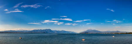 Panoramic view of Lake Garda (Lago di Garda or Benaco), the largest lake in Italy. Lake Garda is a popular holiday location on the edge of the Dolomites in Northern Italy