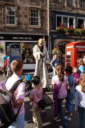 Edinburgh, UK - Aug 9, 2012: Street performer in Yoda costume at Royal Mile touristic street in the Old Town during the Fringe Festival