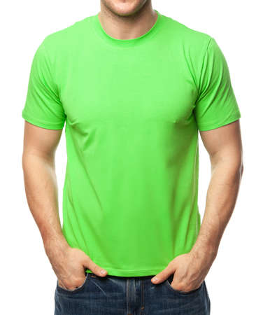 Young fit man wearing blank green shortsleeve cotton T-Shirt. Mock up template isolated on a white background 版權商用圖片