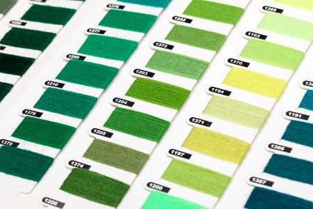 Green and yellow color hue yarn thread sample swatches close-up 版權商用圖片