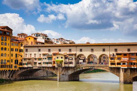 Picturesque Ponte Vecchio (Old Bridge) medieval closed-spandrel segmental bridge with Vasari Corridor (Corridoio Vasariano) elevated enclosed passageway  over the Arno River, a popular tourist attraction of  Florence, Tuscany, Italy