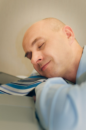 Sleeping on your desktop Stock Photo