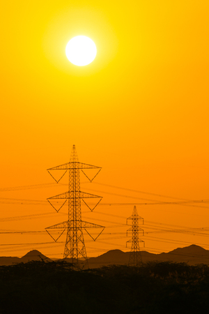 Sunset seen, mountain and electric tower silhouette