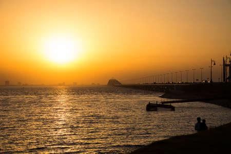King Fahd causeway in sunset background