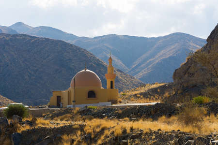 Beautiful mosque at road side with mountain background, beautiful cloudy sky, Banisad, Saudi arabia