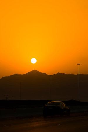 Sunrise scene in Jeddah Makkah express highway with mountain silhouette