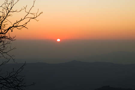sunset from top of mountain in himachal pradesh, India.