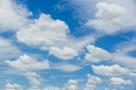 Beautiful Fluffy white cloud flowing against blue sky. Stock Photo