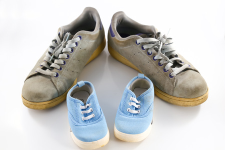 big shoes: big shoes of father and small baby shoes