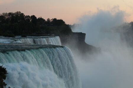 Close up of Niagara falls viewed from usa in twilight, captured as a frozen view of water