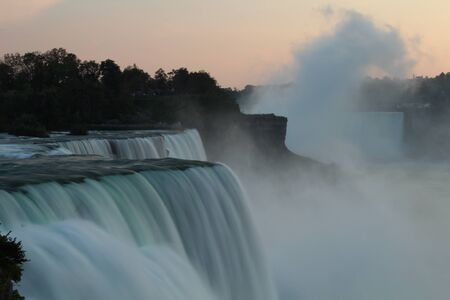 Close up of Niagara Falls in evening as seen from USA, with water flow blurred