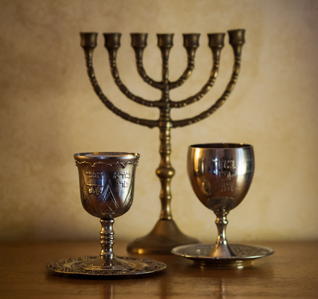 candelabrum: Two silver goblets and a menorah ready for Passover Stock Photo